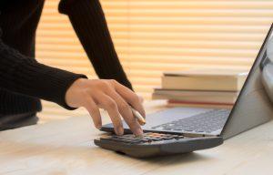 Freelancer calculating her taxes digitally for VAT
