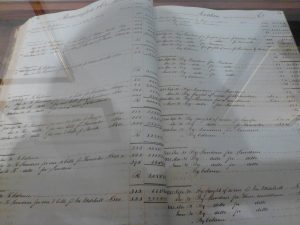 accounting ledger written longhand in copperplate handwriting